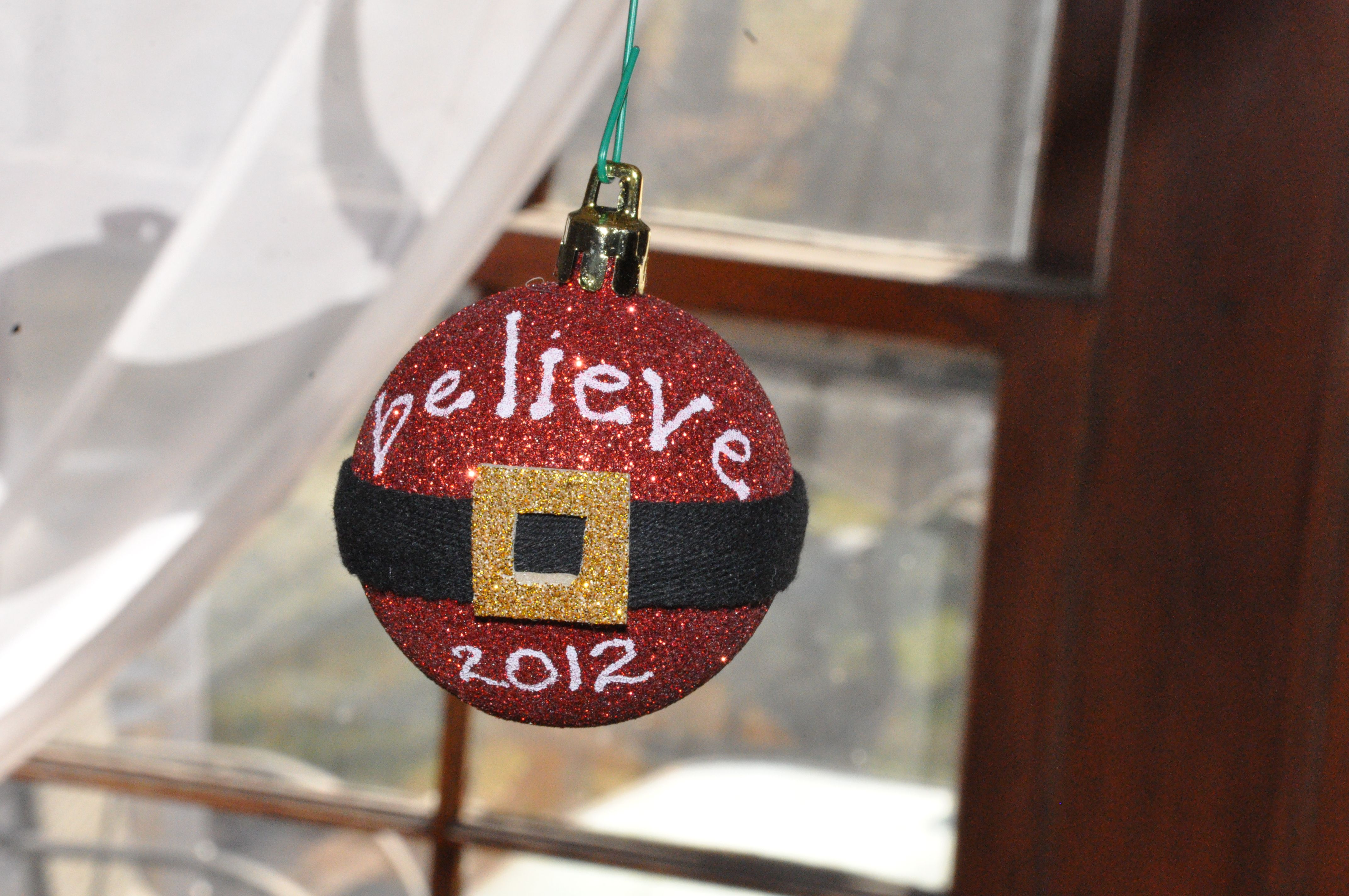 Believe Santa Ornament from Johnston family 2012. Some black ribbon and sparkly foam accents.  One of my favorites. #diy #madebyjackie