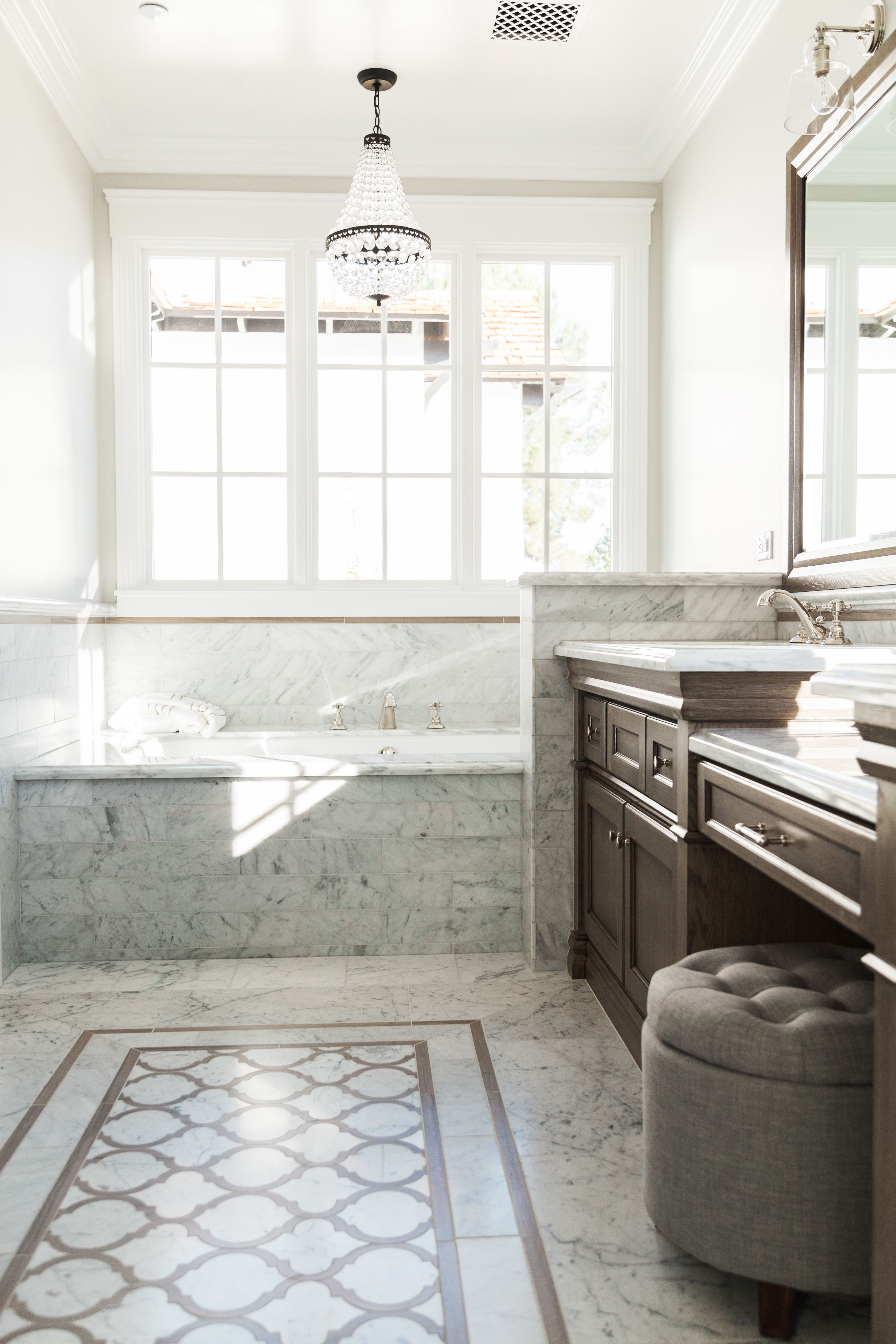 Built in soaking tub with marble surround and marble floor tile - by ...