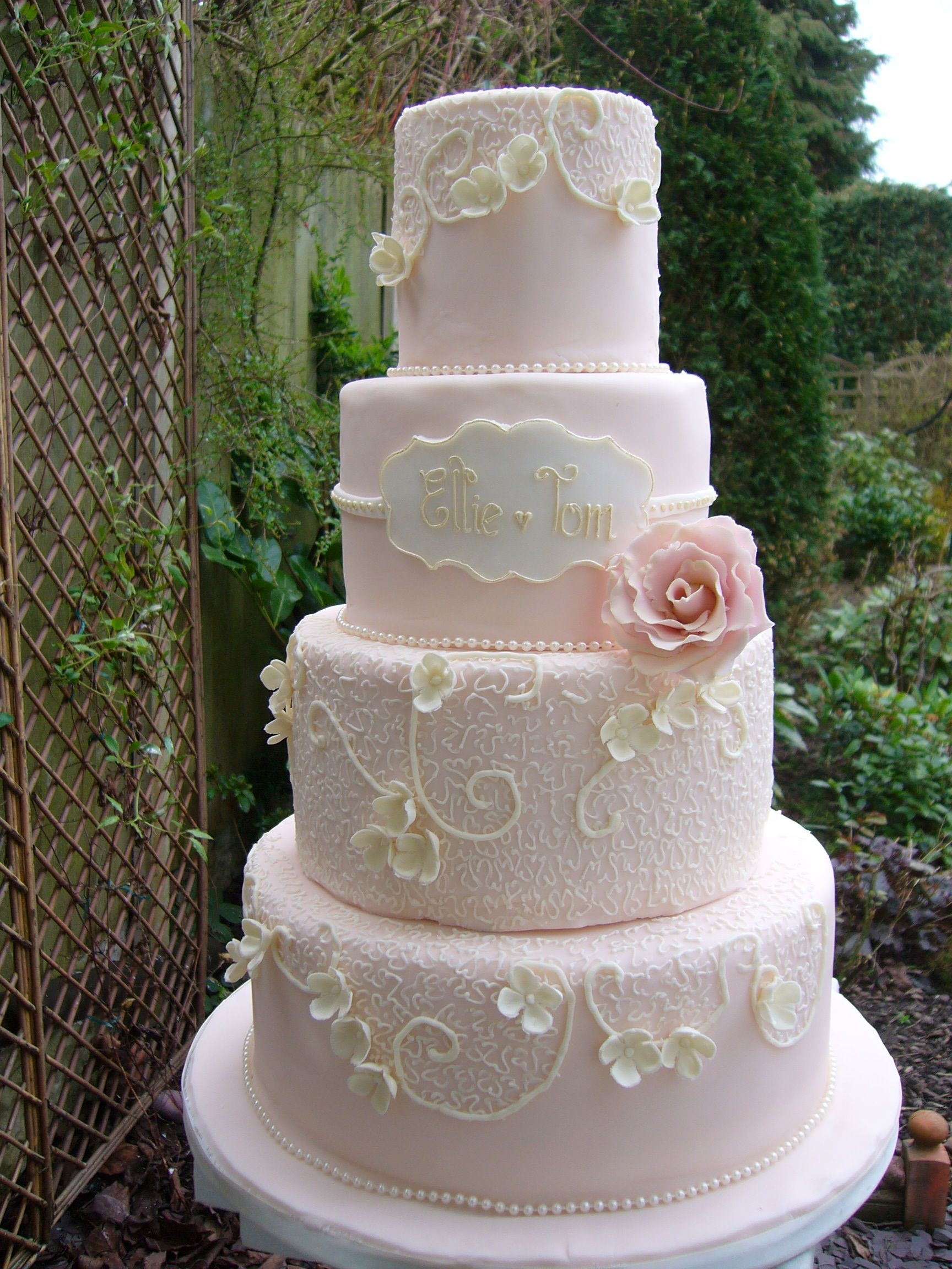 piped wedding cakes four tier blush pink wedding cake with piped lace 18605