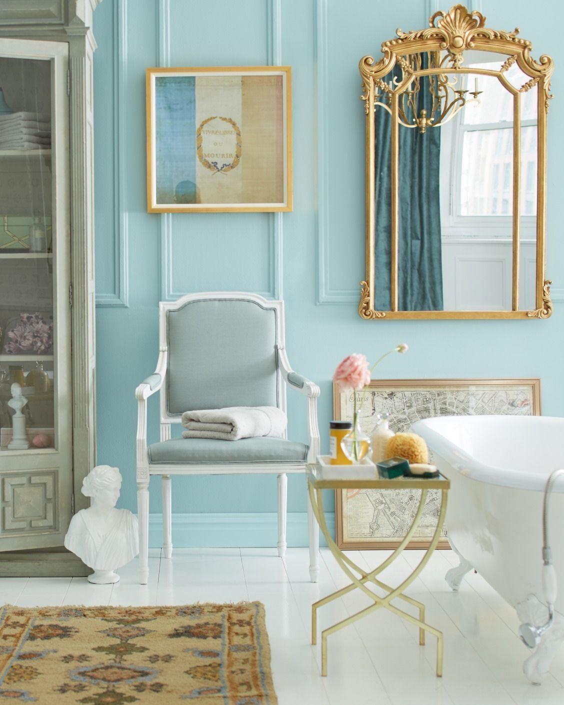 Stunning Parisian-inspired bathroom with light blue walls, bright ...