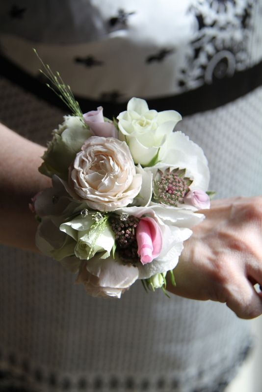 Groom's Mum's Wrist Corsage of Bombastic Roses, Astrantia, Rolled Memory Lane Rose Petals, Snowflake Buds, Hydrangea Florets and Champagne Grass
