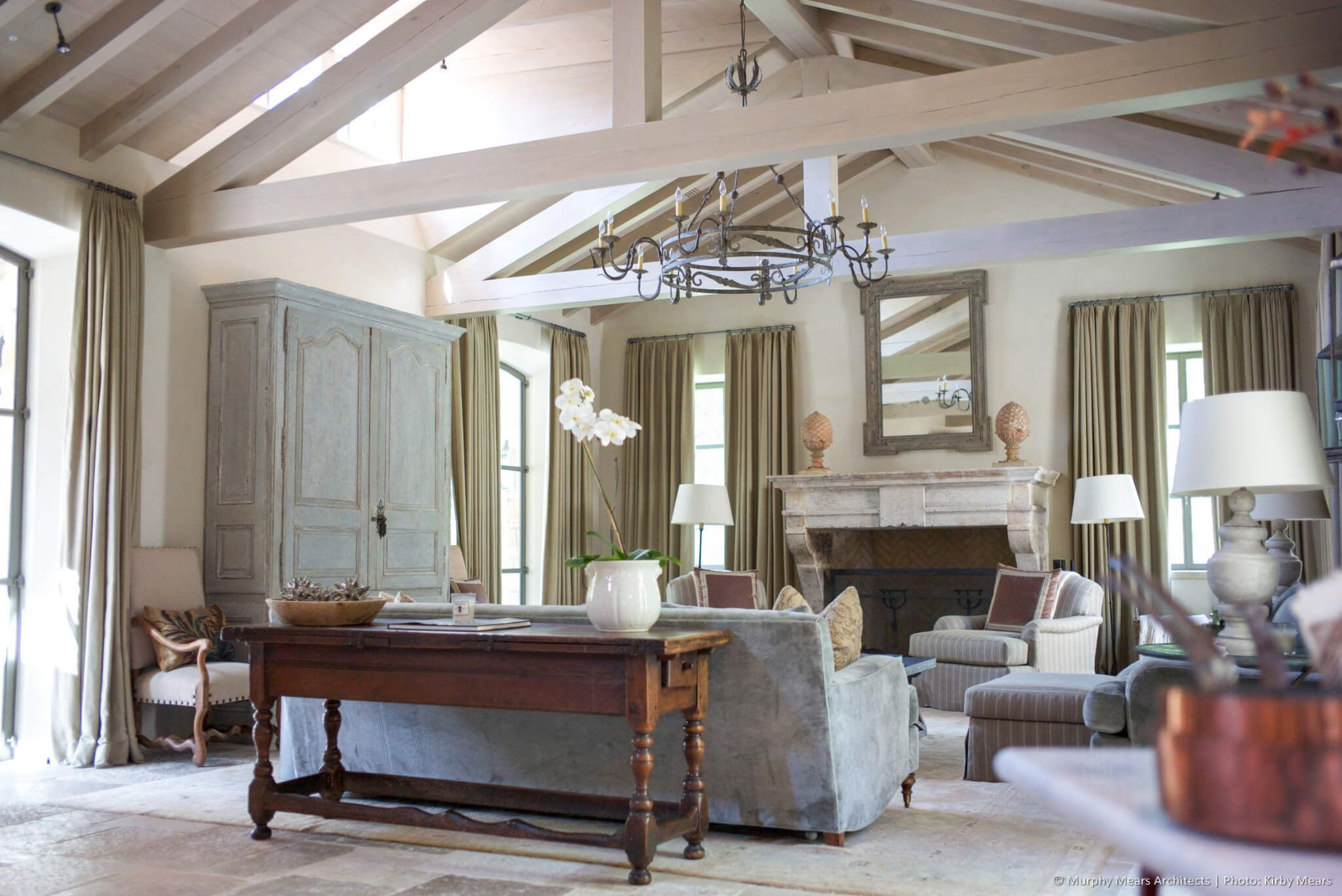 Family Room With Heavy Timber Vaulted Ceiling Continuing From Adjacent