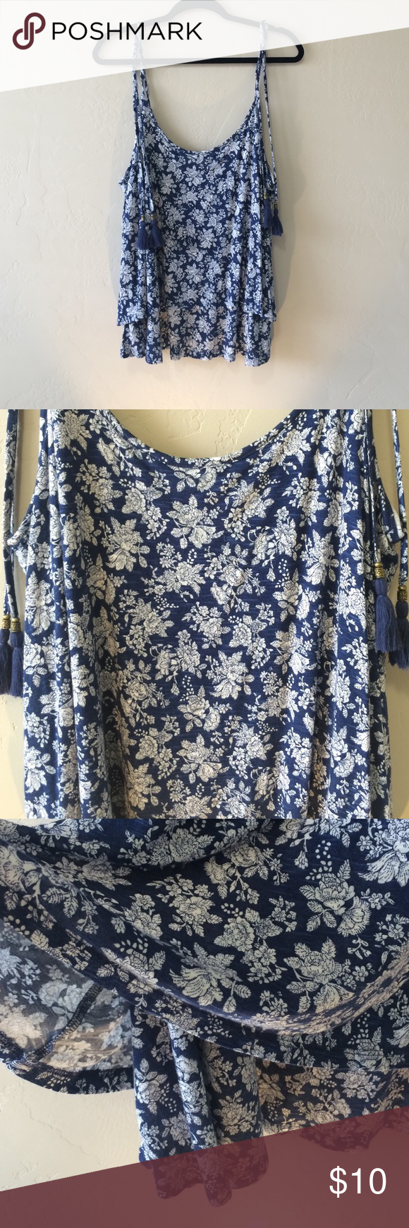 Floral tank with tassels. Needed a flowy tank to wear over a swimsuit however this ended up being too large for me (typically a L to XL in tops). Would be cute paired with jeans and wedges. The straps tie at the top and tassels hang from there. The bottom is two layers. This could be a very flattering top. Never worn. Smoke free home  Forever 21 Tops Tank Tops