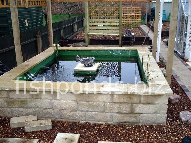 Above ground pond designs building a koi pond finished for Concrete koi pond design