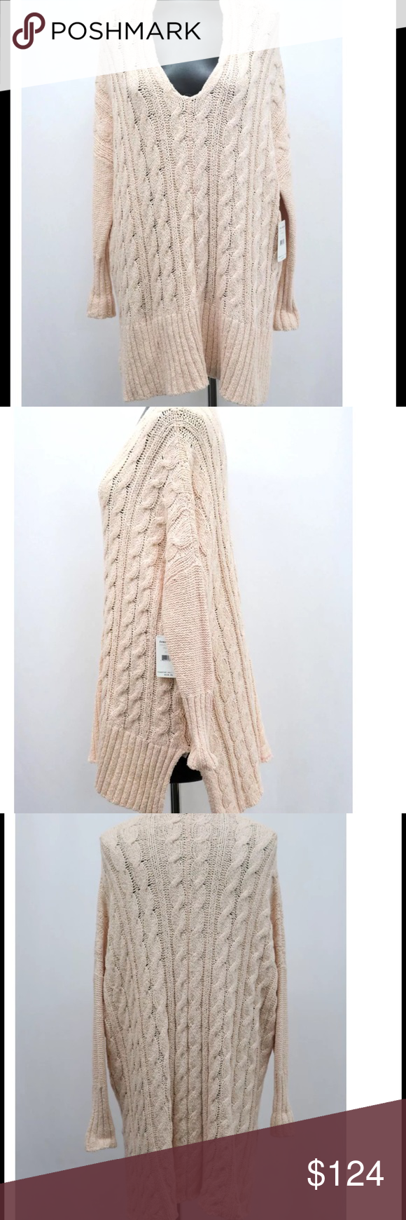 Free People Long Sweater NWT New, perfect, and the prettiest color! Super soft. I absolutely love the way Free People fits. Oversized cable knit sweater with side slits. Warm, cozy, and cuddly! No trades. PLEASE, no. Lowball offers. Free People Sweaters V-Necks