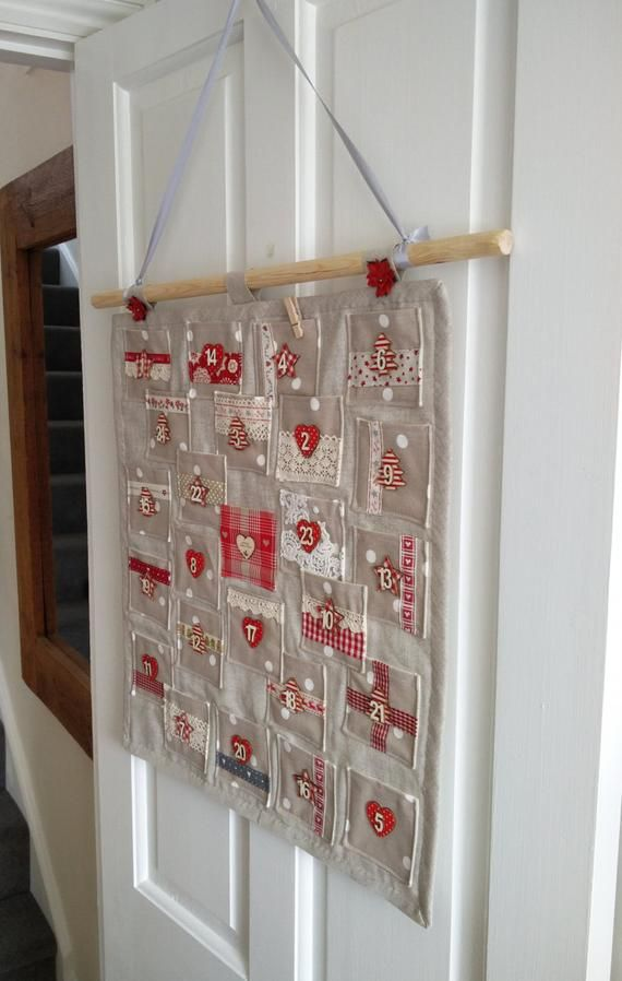 Items similar to Handmade Fabric Christmas Advent Calendar with Gift Pockets on Etsy