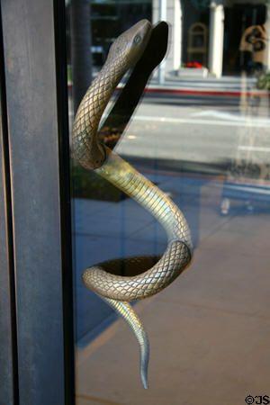 Bronze Snake Door Handle Slithers Through Glass Door On Rodeo Drive Store Beverly Hills Ca Door Glass Design Door Handle Design Glass Door