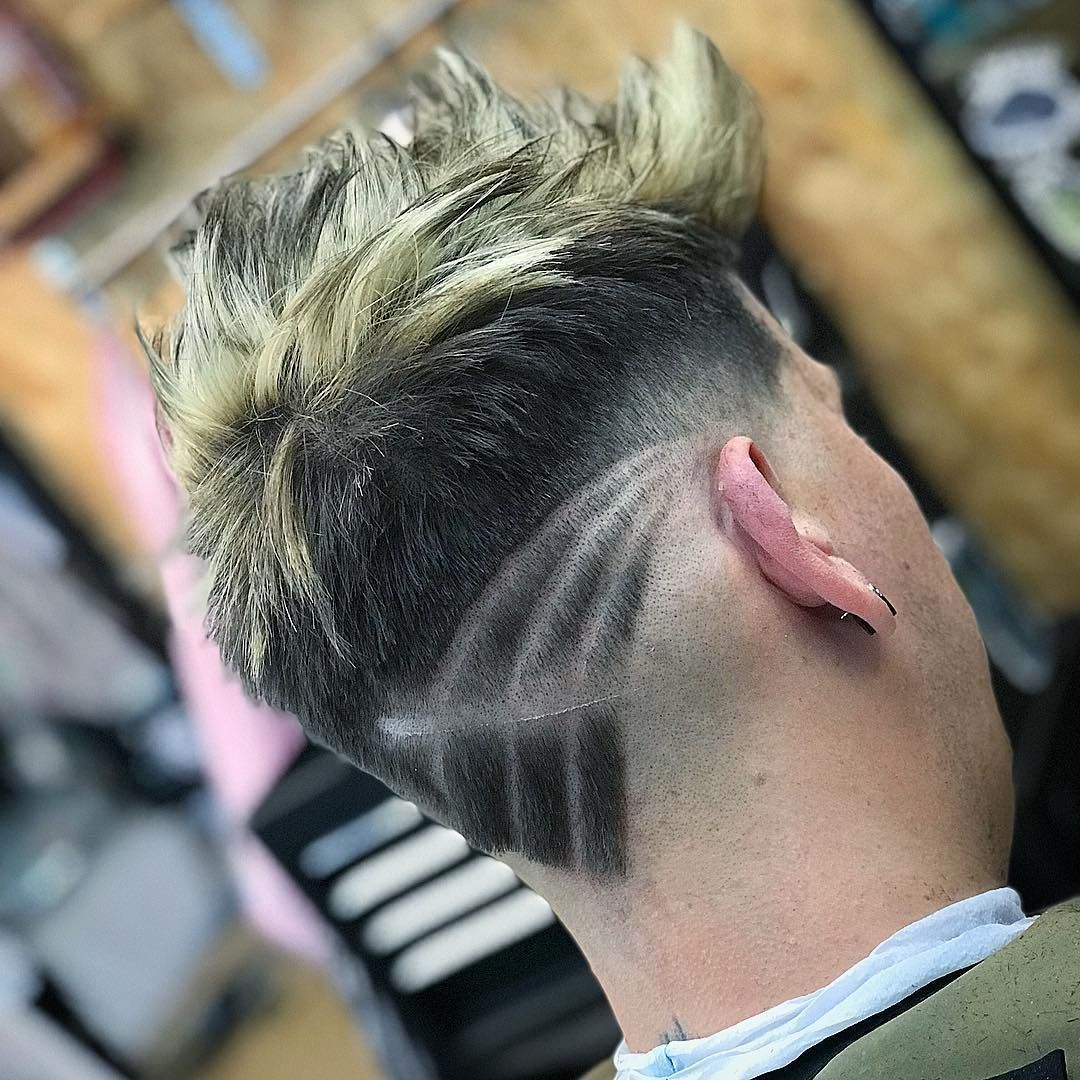 The neckline hair design trend just keeps getting bigger building