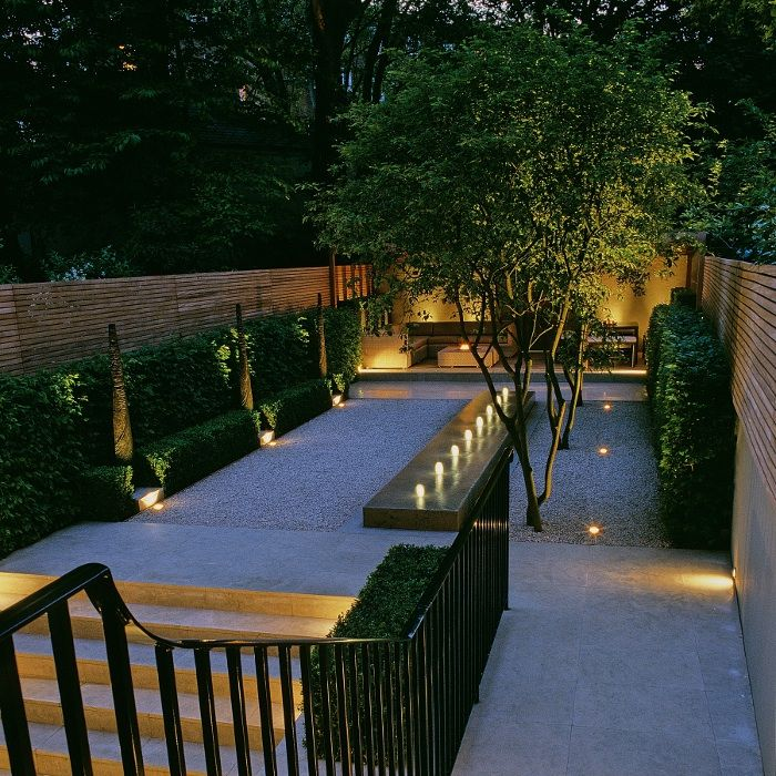 Landform Consultants - South Kensington This minimalist garden features an Andrew Ewing designed water feature and beautiful multi-stem Amelanchier lamarckii trees