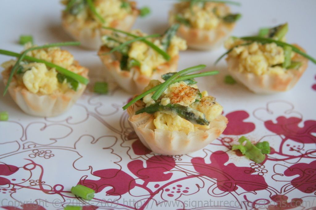 Phyllo cups with asparagus, sping onions, and scrambled eggs.  http://www.signatureconcoctions.com/2009/04/26/foode-couture/#