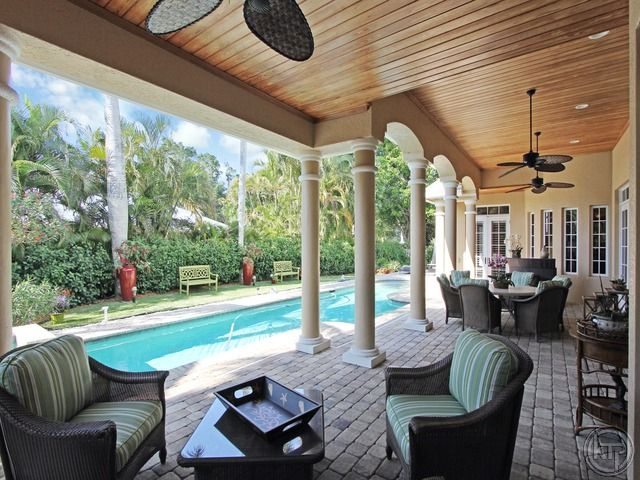 Lanai and outdoor living area pool coquina sands in for Pool design naples fl