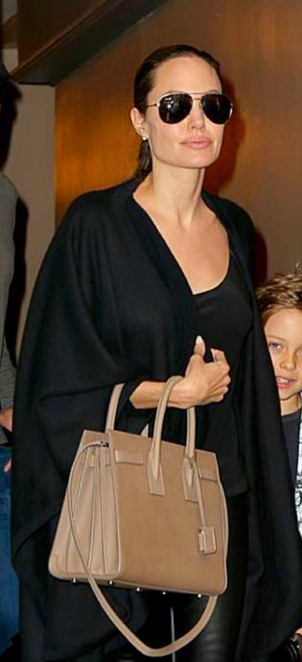 92171375bc Who made Angelina Jolie s black suede pumps