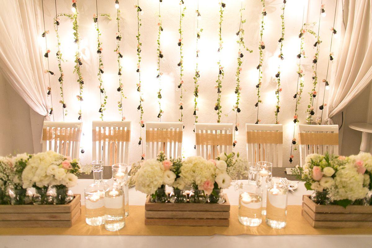 Rustic Wedding Backdrop Of Draped Fabric String Lights