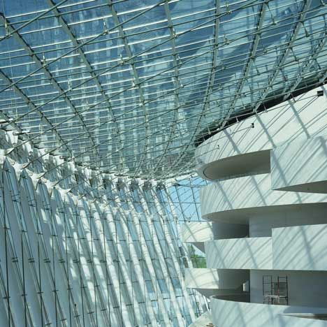 Glass curtainwall and beautiful soft shapes of the walls....Kauffman Center for the Performing Arts to open in Kansas City, MO.