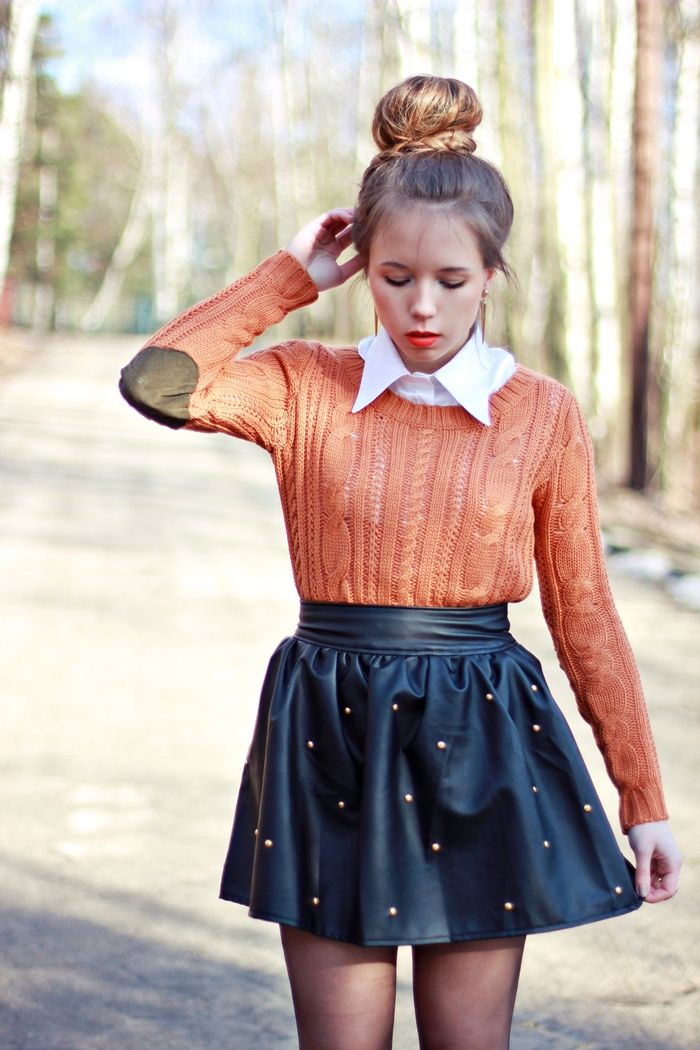Girl, you're doing it right!  Sweater with elbow patches, studded skirt.