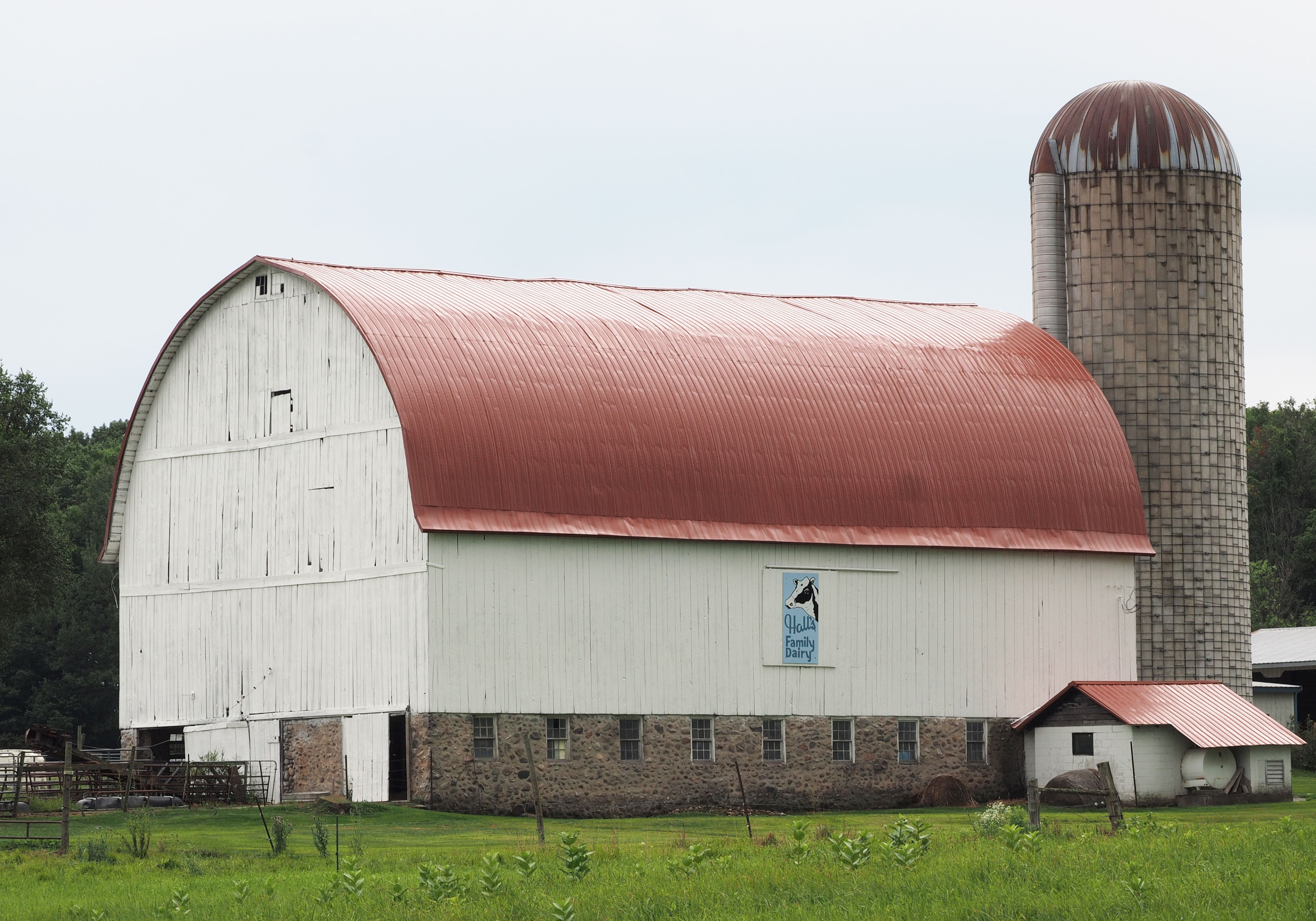Dairy barn with copper roof, Michigan. Farm buildings