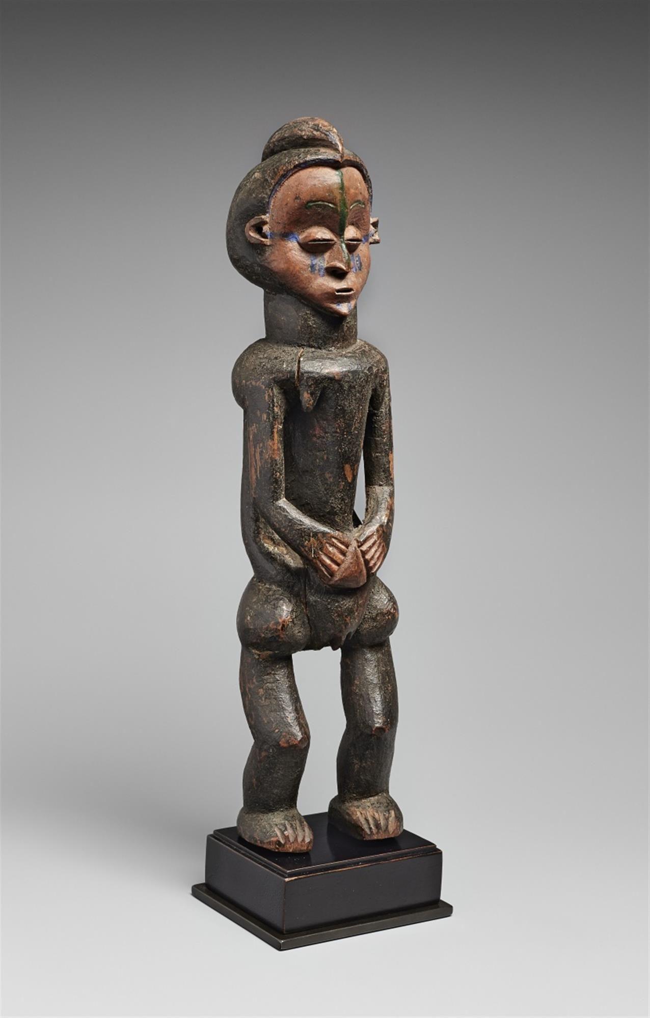Democratic Republic of the Congo, A SUKU/HOLO FEMALE FIGURE #suku #holo #female #figure #sculpture #african #congo #lempertz #art #artauction