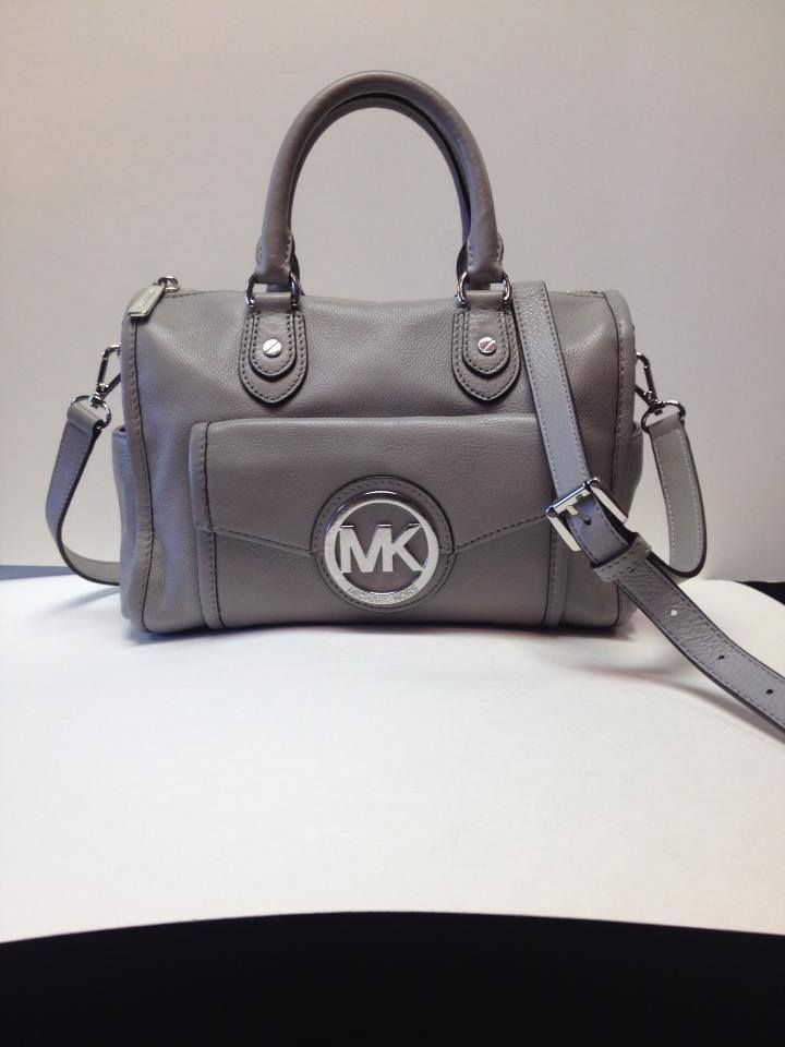 Michael Kors...love love.  At Ms. Mulligan's Consignment Boutique