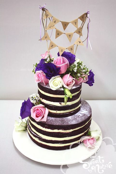 Naked Birthday Cake Complete With Bunting And Fresh Flowers