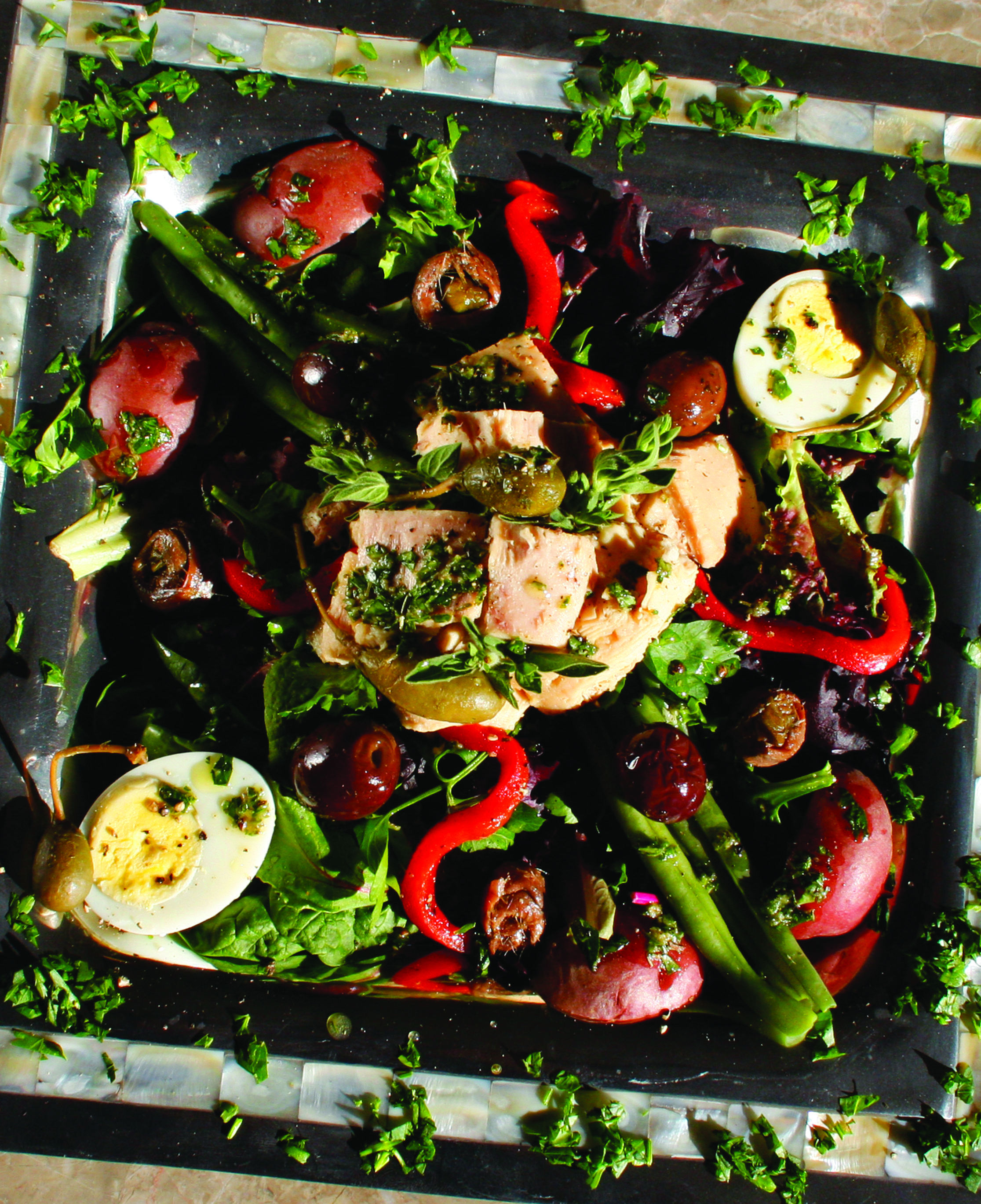 Nicoise Salad - A variety of vegetables topped with tuna and hard boiled eggs. A great meal for any day of the week!