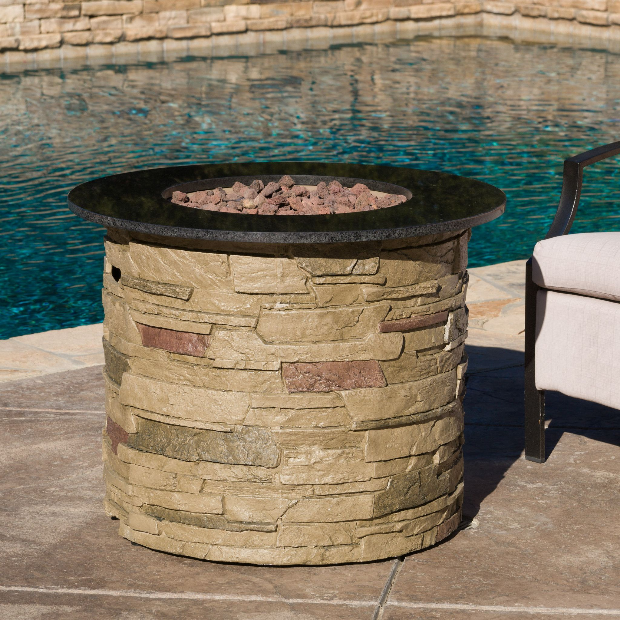 rogers outdoor round propane fire pit with lava rocks fire pit