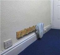 Here is a genius way to keep your shoes by the door - get a coat rack and hang it by the floor. No more messy shoes crowding the door way.