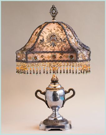 Chrome Plated Antique Lamp Reminiscent Of A Silver Tea Service Holds A Hand Dyed Sterling Gent