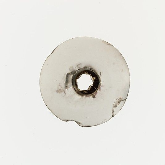 Rock crystal spindle whorl  Period: Middle Minoan I-Late Minoan I Date: ca. 2200-1450 B.C. Culture: Minoan Medium: Rock crystal Dimensions: Diameter 3/4 in. (2 cm)