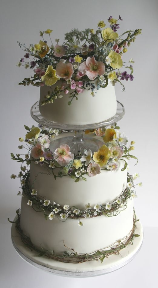 An exquisite summer meadow wedding cake of handcrafted sugar flowers  made by Amy Swann Cakes yswanncakes country chocolat mariage cake cake country cake recipes cake sim...