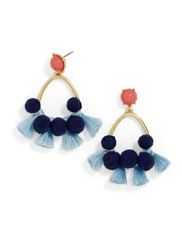 Melina Pom Pom Earrings is part of Pom pom earrings, Tassel drop earrings, Textile earrings, Baublebar earrings, Drop earrings, Earrings outfit - Threaded tassels and a navy pom pom fringe decorate frontfacing hoop earrings  For the ultimate ontrend statement, pair with a cold shoulder top or frills