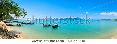 Traditional Thai boats for tourist near the beach Thailand. Panorama of Panwa Bay Phuket.