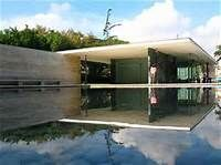 german pavilion mies van der rohe - space as geometric abstraction meticulous proportion floor to veiling glass, green marble, travertine, no enclosing walls free pland and flowing, simplicity of interior with color and tecture as ornamentation,less is more, furniture in colaboration with lily reich