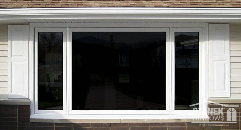 White Casement Windows In A 1 5 3 5 1 5 Configuration The Middle Window Is Fixed Learn More Casement Windows Window Trim Exterior Casement