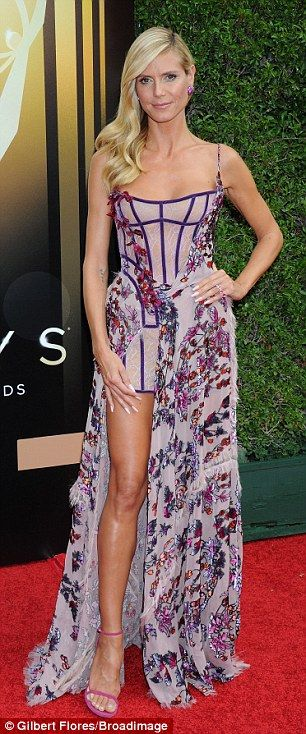 Flower power: The former Victoria's Secret Angel's ensemble consisted of a lacy lingerie-style micro-mini dress draped with long sweeping fabric featuring an exotic blossom print jαɢlαdy