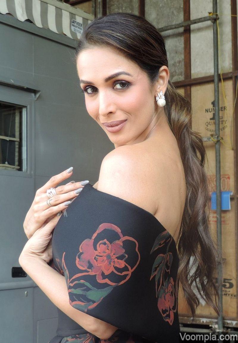 2a4411205e3 Malaika Arora Khan on the sets of India s Got Talent in an off-shoulder  Saiid Kobeisy dress. via Voompla.com