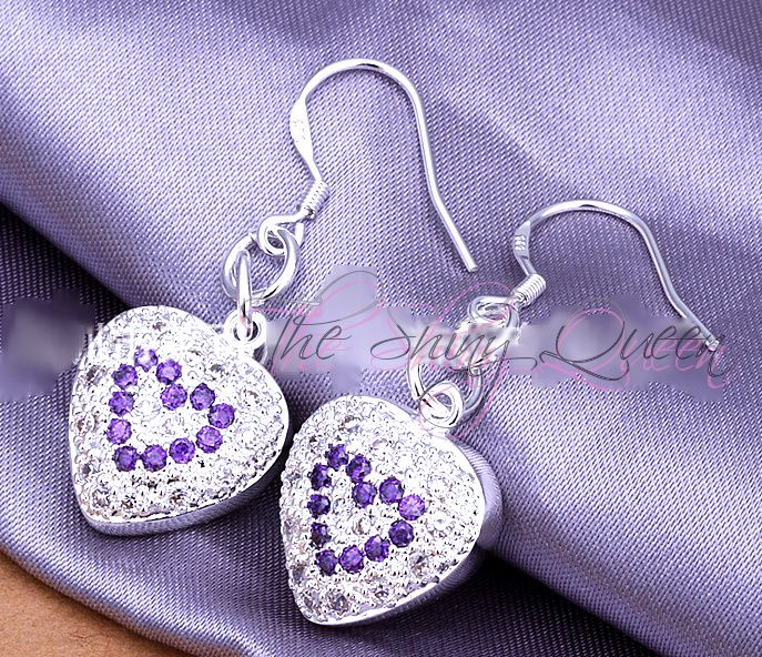 These darling earrings have a high polish, bright silver plated heart charm. This puff heart charm has micro pave White and Tanzanite CZ stones with sterling filled french ear hook. 2.5 inches.
