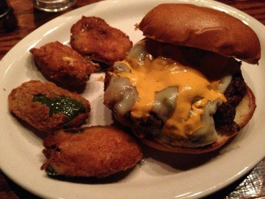 """Olde Magoun's Saloon (Somerville, MA). """"Order the Death Wish burger, forged from a mix of chipotle, ghost, habanero, and jalapeño peppers, pepper jack cheese, Sriracha, and sour cream."""""""