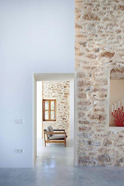 Casa payesa en Formentera, con suelos de cemento Taller - paredes de cemento