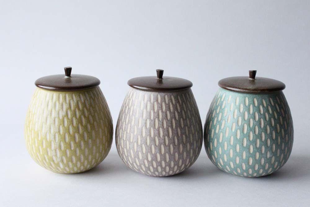 Incised lidded jar by Mayumi Yamashita (tall models in yellow, purple and blue)