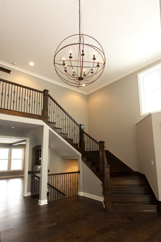 Dramatic Front entry way. Walls are painted Mindful gray