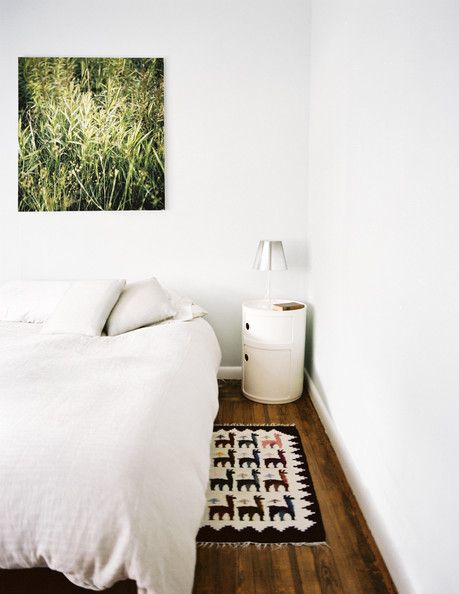 Bedroom Minimalist Photo A Square Photograph And Bed Outed With White Bedding Beside Small Side Table