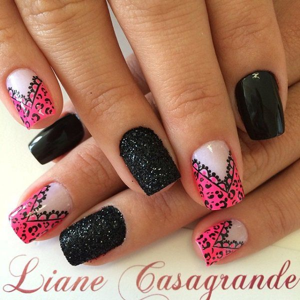 This pink nail art design comes out as rather chic and strong. Using a clear coat as base color pink lacey French tips are added on top with black colored details, black matte polish is also used.