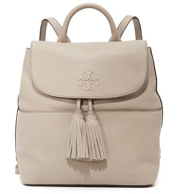 cc077cd4d8a0 Thea backpack by Tory Burch. A sophisticated Tory Burch backpack with  decorative tassels