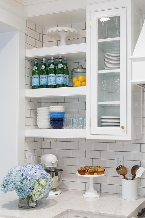 white floating shelves are mounted beside glass front on floating shelves kitchen id=88262