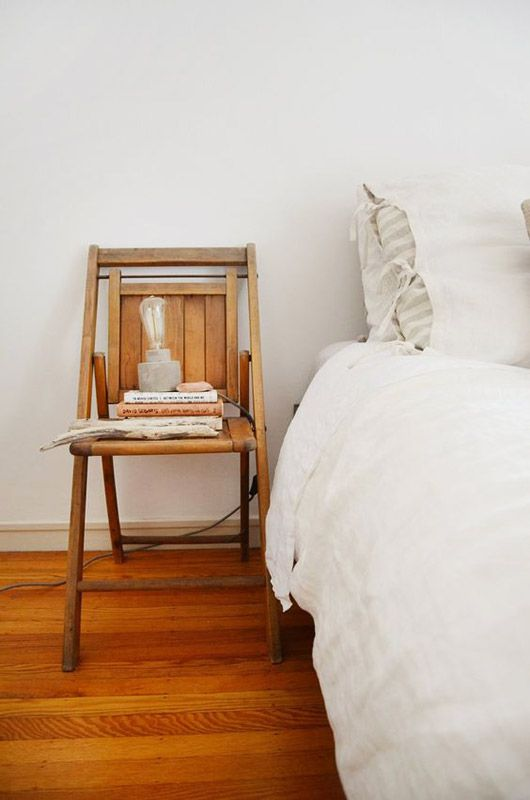 Simple Vintage Inspired White Bedroom Wooden Floors Vintage Chair Is Used As A Bedside Table White Bedding Nail The All Home Decor Bedroom Bedroom Vintage Retro Dining Chairs