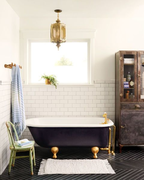 The find: A 1920s claw-foot tub ($200) that Coley found on Craigslist. She had the inside resurfaced for $125, painted the outside black, and added polished brass fixtures. How it makes the room: With its classic design and modern updates, the tub inspired the room's old-meets-new mix. Black porcelain floor tile, laid in a herringbone pattern, adds an unexpected edge. A chippy green chair, an antique Moroccan lantern, and a storage cabinet salvaged from an aircraft carrier offset the sleek…