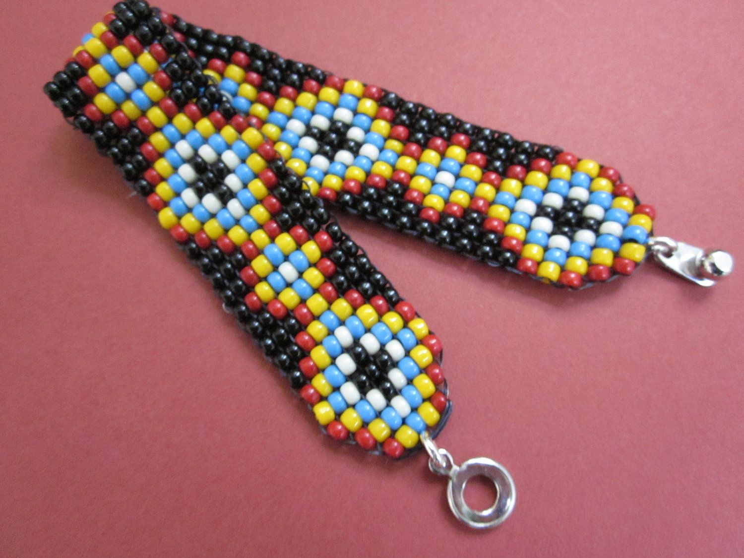 hand loomed seed bead friendship pattern squarestitch bracelet. $36.00, via Etsy.
