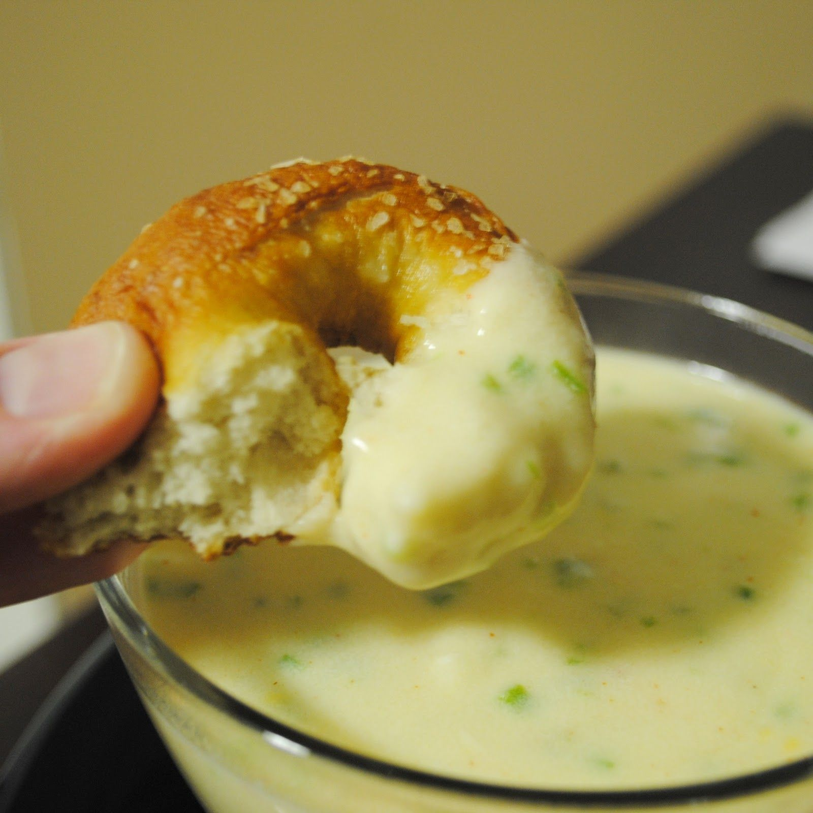 Homemade soft pretzels with jalapeno cheese sauce.