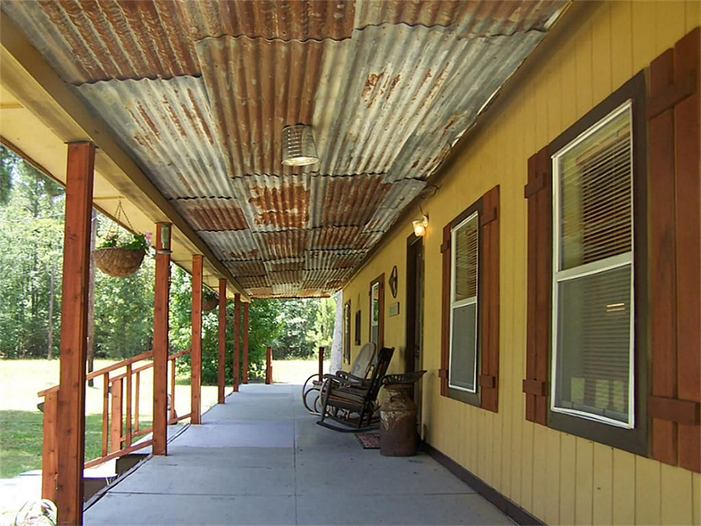 Cute rustic tin ceiling on front porch knotty pine for Rustic front porch