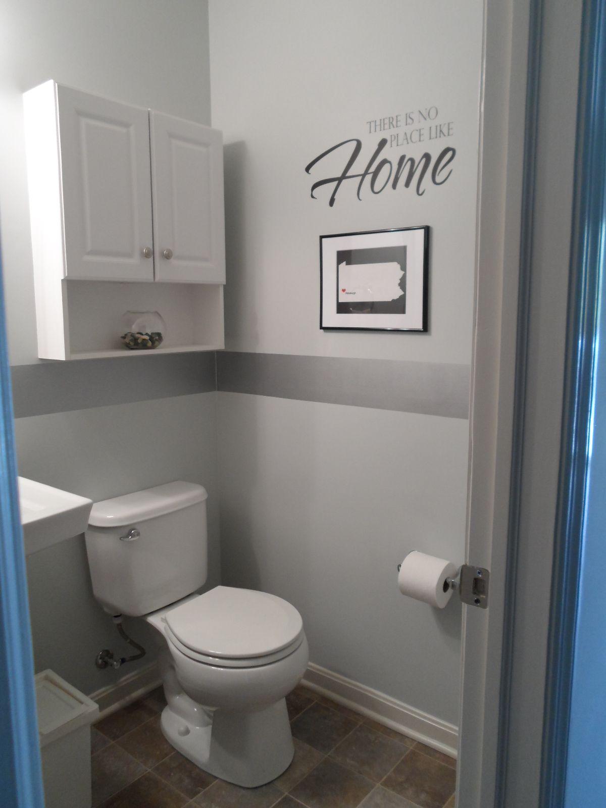 the half bath on the main level light blue with a